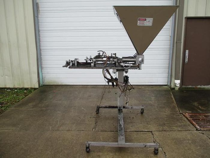Used Hinds-Bock Dual Piston Filler;