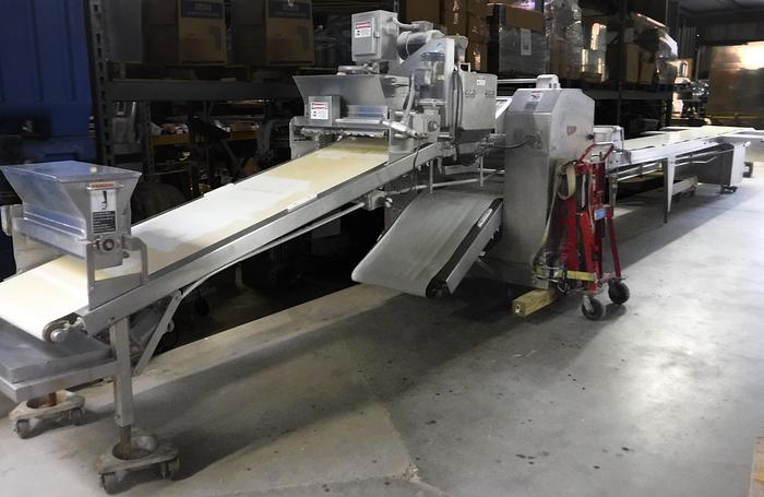 Used USED STAINLESS STEEL MOLINE 38-FOOT SHEETER LINE WITH EXTRUDER