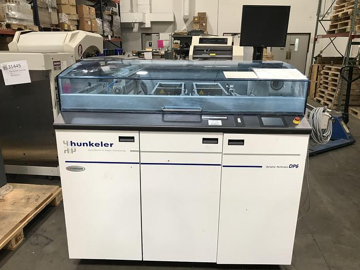 Used 2011 - Hunkeler DP6-II 7508 Dynamic Perforator, 150 m/min