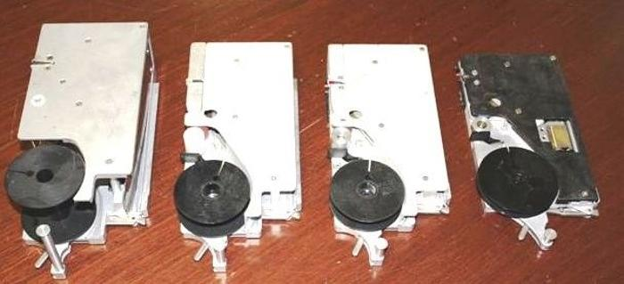 Used Quad tape and reel feeders - several models and most sizes
