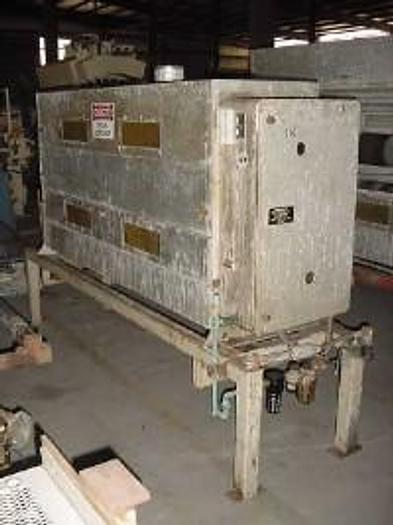 """Used 66"""" Solo 2 side treater station with Epoxy covered rolls."""