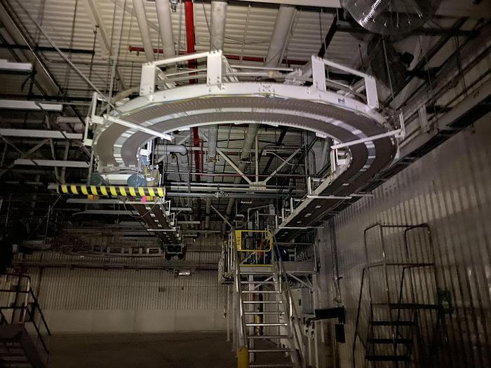 Used 1000' OF ROLLER CONVEYOR WITH CURVING TRACK