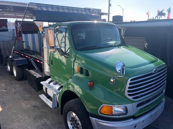 Used 2010 STERLING DETROIT MOTOR  ROLLOFF