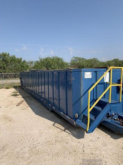 Used Open Top Workover Tank on a Rock Over Trailer