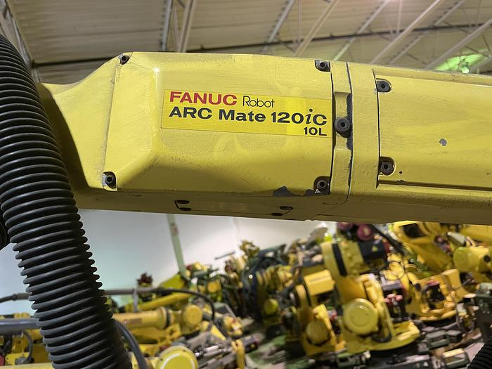 Used FANUC ARCMATE 120iC/10L MIG WELDING CELL WITH 2 AXIS 10' LONG DROP CENTER TRUNNION W/ROTARY CNC TABLE