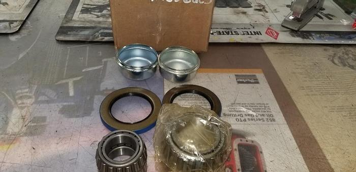 NEW SURPLUS 42656UC3  TRAILER HUB BEARINGS & SEALS WITH GREASE CAPS