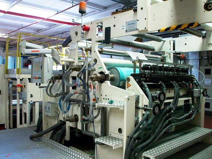 2004 Nonwoven - Hot melt application complete line  (unwinder, Hot melt coater, surface inspection, rewinder, packaging)