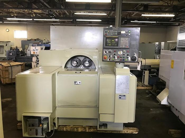 1996 KITAKO MT4-200 1996 4-SPINDLE CNC HORIZONTAL TURNING CENTER