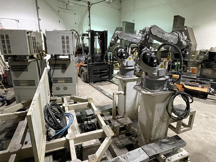 Used MOTOMAN EA1400N DUAL ARM ROBOTIC MIG WELDING CELL WITH 11,000 LB CAPACITY A/B SIDED INDEX TABLE