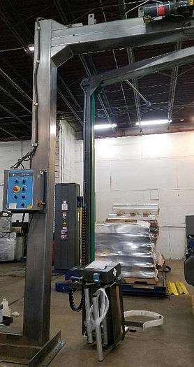 Used Cousins Rotary Arm Semi-Automatic Pallet Wrapper
