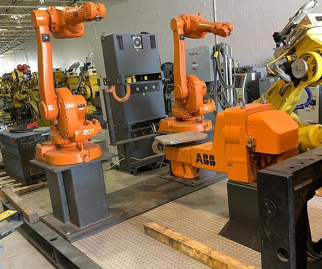 Used ABB  IRB 1600-5/1.45 DUAL ARM ROBOTIC CELL WITH ABB TYPE MTC 750 POSITIONER AND IRC5 CONTROLLERS