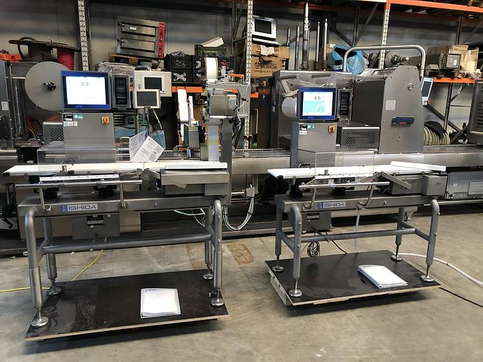Used Ishida checkweigher with automatic reject system.
