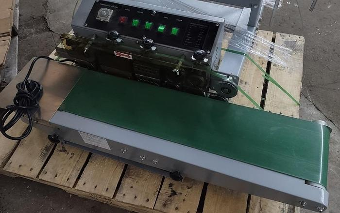 Used Horizontal Table top band sealer