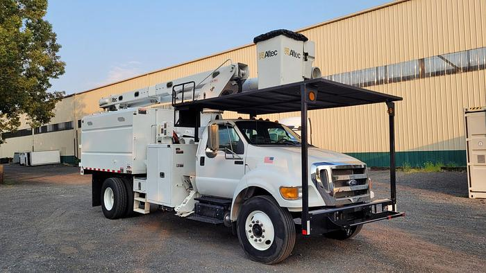 Used Altec LR760-E70 75ft Forestry on 2015 Ford F750 Extended Cab Chipper Dump Truck - M27100