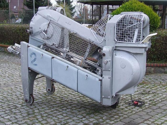"""Używane """"BAADER 170"""" - Fileciarko-odgławiarko-patroszarka do ryb płaskich-flądra, itp."""