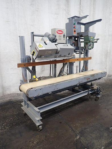 Used Newlong bagging scale with Heat Saler