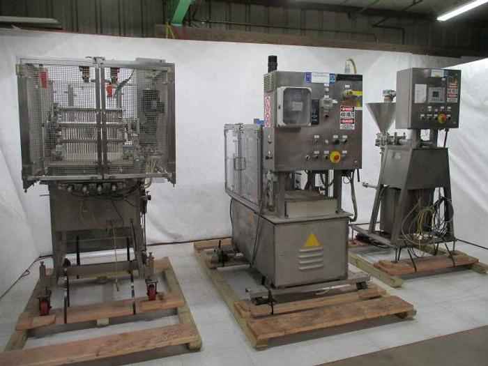 Used Mondini Cup Filling & Sealing Line for Solids ans Liquids
