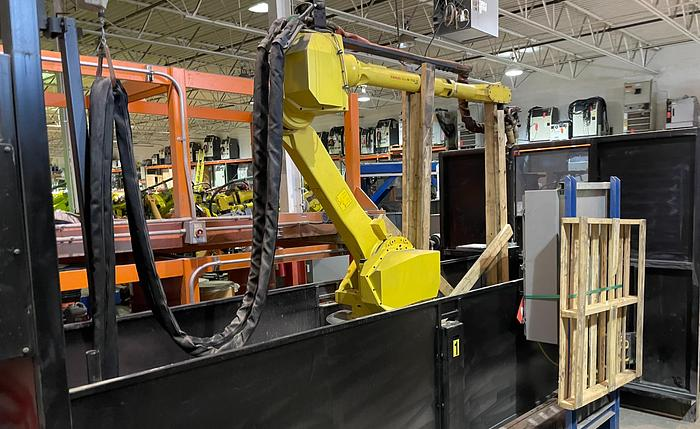 Used LINCOLN SYSTEM 55 WITH FANUC M710iC/20L TORCH CUTTING CELL WITH DUAL ROLL IN ROLL OUT TABLES
