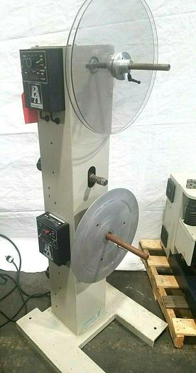 Used PA Industries Double Coil Motorized Stock Reel with Paper Interleaf Payoff Feed