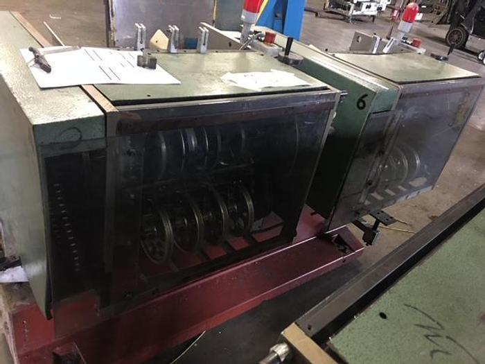 Used MULLER MARTINI MODEL 279 FEEDER POCKETS W/ BASE