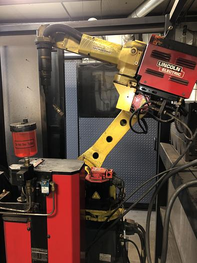 Used FANUC ARCMATE 200iB MIG WELDING CELL WITH A/B SIDED INDEX TABLE AND 7TH AXIS SERVO HEADSLTOCK