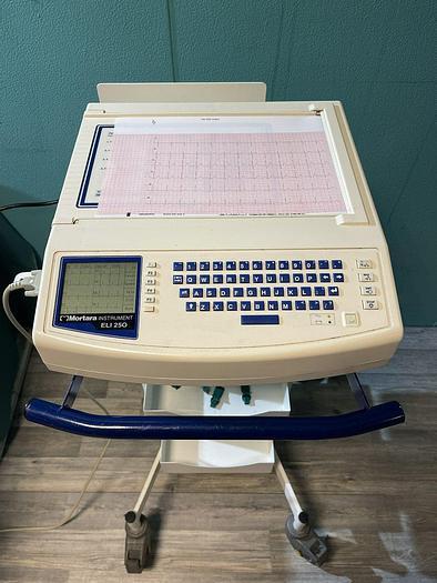 Gebraucht Mortara Instrument ELI 250 EKG Gerät auf Trolley mit EKG Kabel
