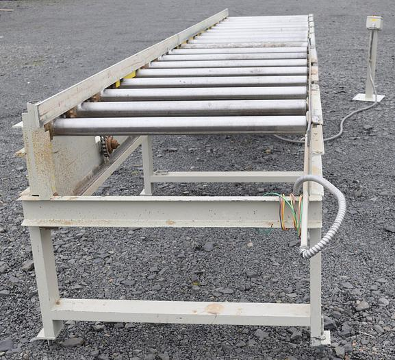 Used 18ft Power infeed table roll case with straight edge.