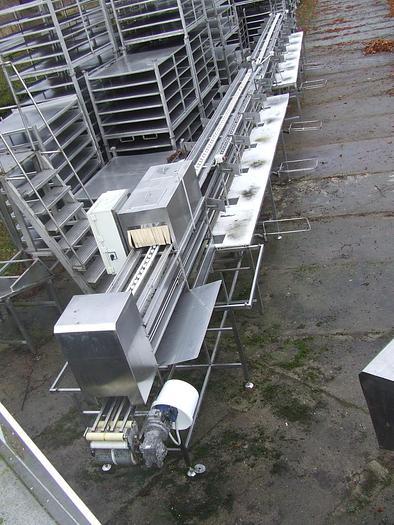 Używane 24-stanowiskowa linia (stół) do ręcznego nakładania produktu w puszki (pojemniki)