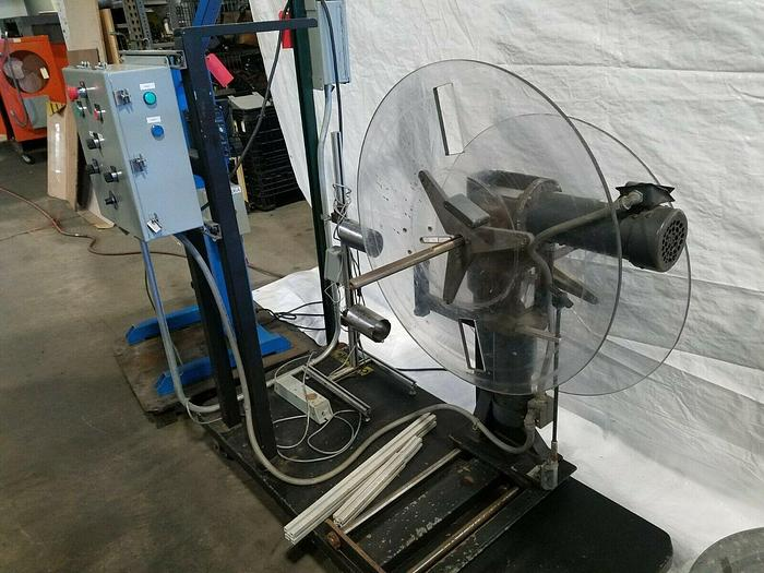 Used Rapid Motorized Double Sided Stock Reel Material Feed with control panel
