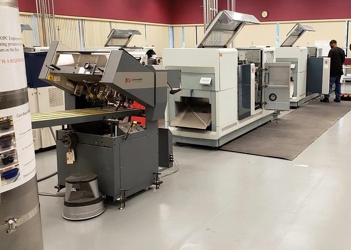 Oce Variostream 8750 TWIN Printing System (Pinless - 208M Foot Count) - Tecnau Roll to Fold (LX550 Unwinder / F4 Folder)