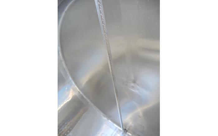 USED 500 GALLON JACKETED TANK, STAINLESS STEEL, HORIZONTAL, INSULATED, WITH MIXER