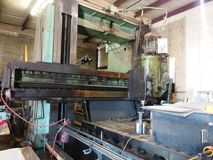 "Used 1958 Cincinnati Hypro Planer Mill, 82"" X 252"" Table,  96"" Under Rail, 50 HP Heads, 100"" Between Columns"
