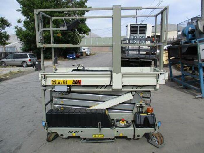 Used MAX MOVE MINI 61 500 LB MAN LIFT 20 FOOT HIGH CAPACITY WITH UNIVERSAL STEERING