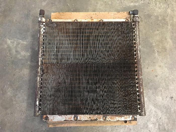 "GOOD USED OIL COOLER, LENGTH: 23"" W X : 22"" L X 2"" THICKNESS"