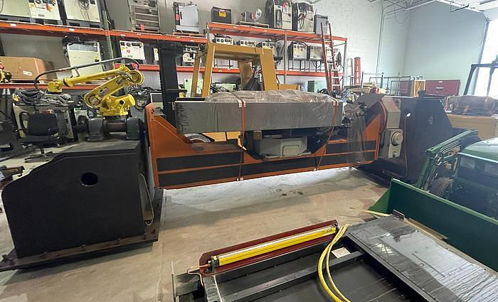 Used 2011 FANUC  ARCMATE 120iC/10L MIG WELDING CELL WITH 2 AXIS 10' LONG DROP CENTER TRUNNION W/ROTARY CNC TABLE