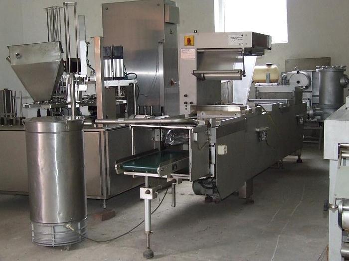 Używane Maszyna pakująca próżniowa w ruchu ciągłym – Multivac M 855 F PC