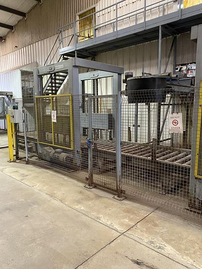 Used Rolling road where you place in two boxes stacked on top of each other, the machine destacks the two boxes. They then stop at the filling conveyor, once full they are stacked back on top of each other to be removed by a FLT