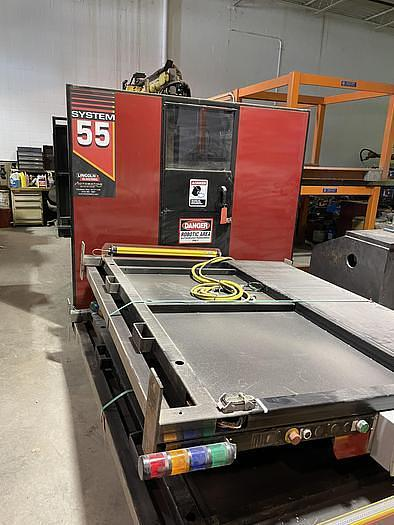 Used LINCOLN ELECTRIC SYSTEM 55 WITH FANUC M710iC/20L TORCH CUTTING CELL WITH DUAL ROLL IN ROLL OUT TABLES