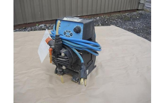 Used USED METERING PUMP, 3.38 USG/HOUR, 100 PSI