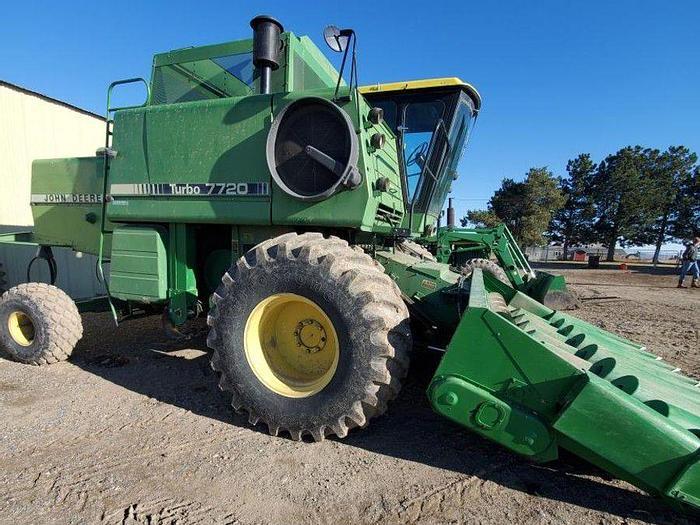 Used John Deere 7720 Combine w/ Corn + Grain Headers