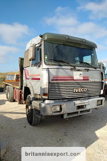 Used 1990 Iveco Turbostar 190-36 6X2 flatbed truck.