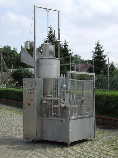 Używane Dozownica 2 -tłokowa, 2-rzędowa karuzelowa do opakowań plastykowych i aluminiowych ze spawaniem wieczek, Grunwald.