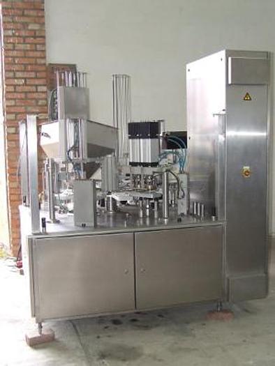 Używane Karuzelowe urządzenie do dozowania pasztetów, past, zup, gulaszy, itp. z napawaniem pokrywek aluminiowych