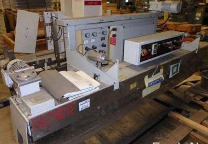 Used Fischbein Model DRC400EC RL Bag  Sealer