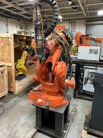 Used LINCOLN ELECTRIC  IRB 2400 ROBOTIC LASER WELDING CELL WITH DUAL ABB IRBP 2000L DUAL TRUNNIONS