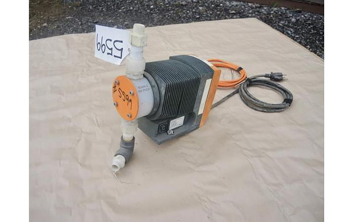 Used USED METERING PUMP, 4.5 USG/HOUR, 58 PSI